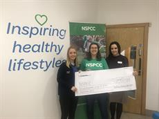 Inspiring healthy lifestyles present a cheque for £950 to the NSPCC