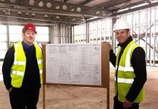 Ashton Leisure Centre's Duty Manager Danny Allen and Inspiring healthy lifestyle's Development Manager Stuart Holden inspect the ongoing work