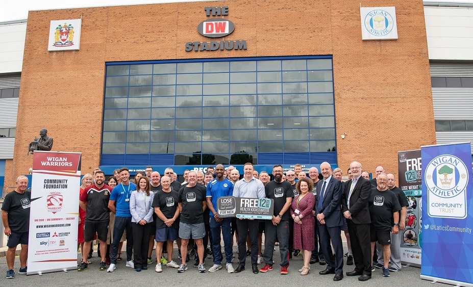 Stakeholders from Wigan Athletic, Wigan Warriors, Wigan Council and Inspiring healthy lifestyles with Lose Weight, Feel Great FOR MEN participants at the DW Stadium